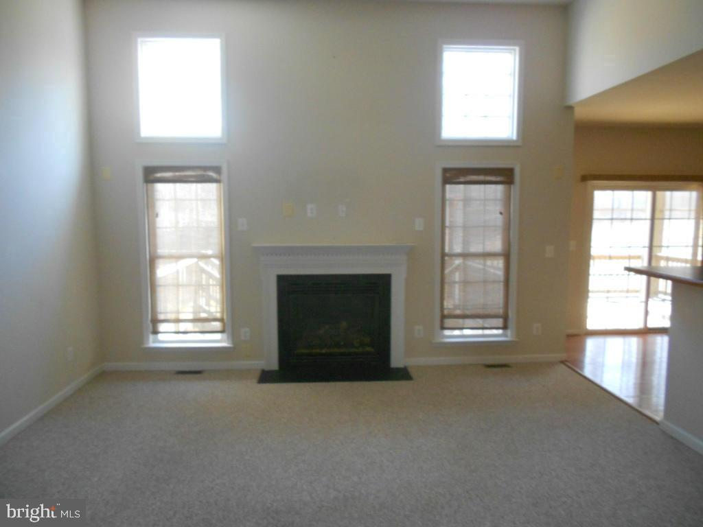 2 story family room with gas fireplace - 11705 WILDERNESS PARK DR, SPOTSYLVANIA