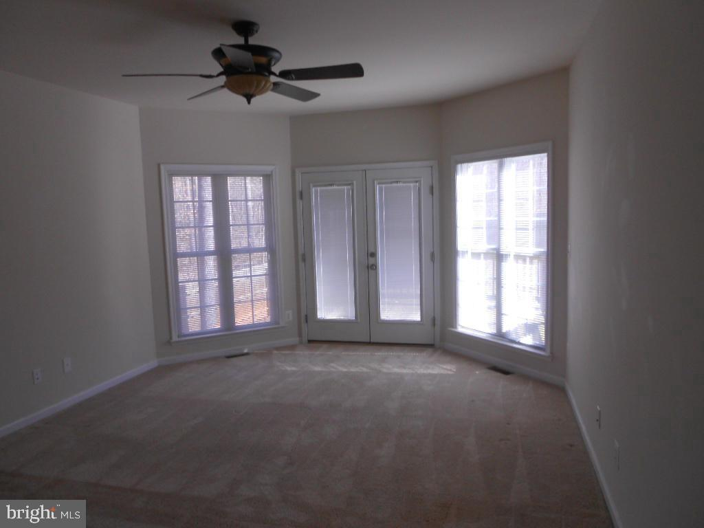 Master bedroom with bay window and private deck - 11705 WILDERNESS PARK DR, SPOTSYLVANIA