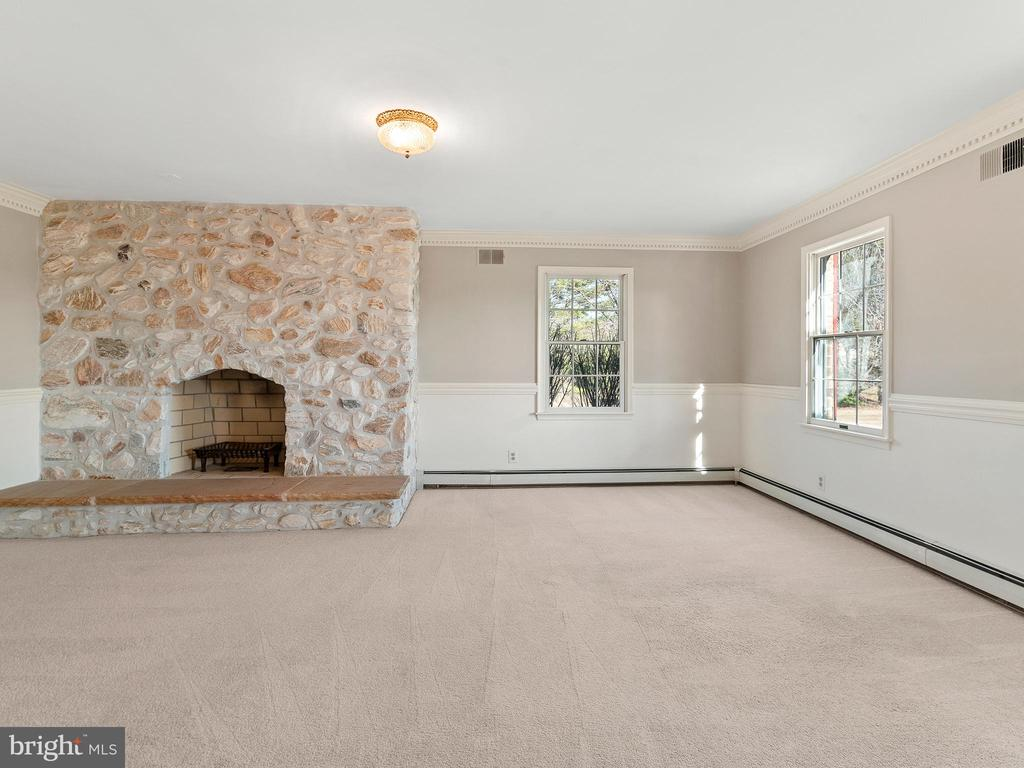 Formal Living Room with 2nd Massive Fireplace - 12143 RICHLAND DR, CATHARPIN
