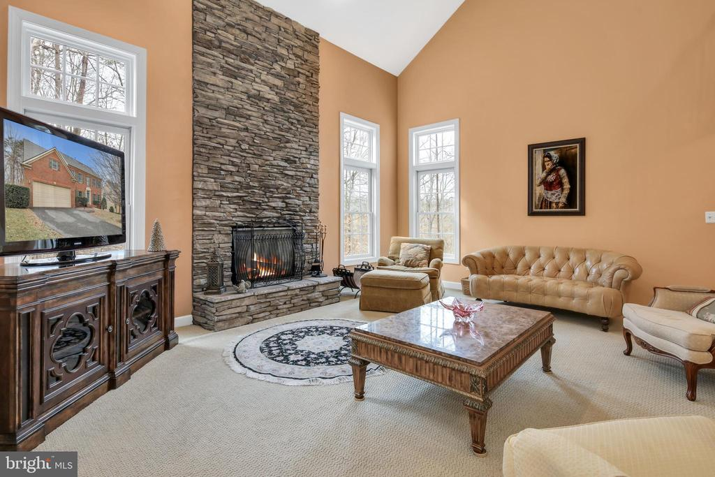 Rugged stone stack wood burning fireplace - 47285 OX BOW CIR, STERLING