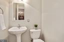 Main level half bath, convenient for guests - 1575 N VAN DORN ST, ALEXANDRIA
