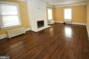 living room with hardwood and woodburning FP - 909 WEST KING, MARTINSBURG