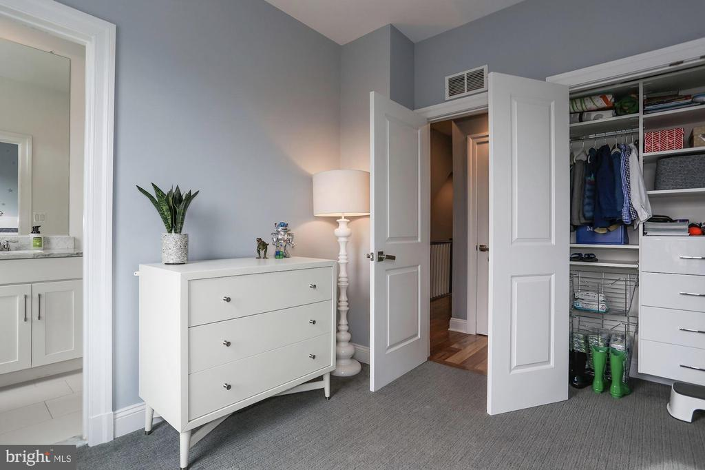 Closet outfitted with custom cabinetry - 4523 WILSON BLVD, ARLINGTON