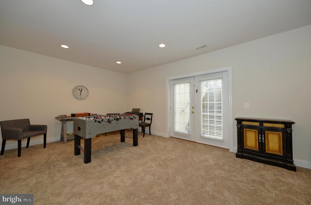 Game Area with French Doors to the Walk-up Stairs - 36335 SILCOTT MEADOW PL, PURCELLVILLE