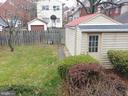 Rear of home feat. yard and detached garage. - 4025 20TH ST NE, WASHINGTON
