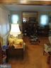 Living room feat. Brick fireplace. - 4025 20TH ST NE, WASHINGTON