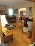 Living area leads to separate dinning room. - 4025 20TH ST NE, WASHINGTON