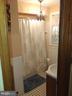 Main upper level bathroom off hallway. - 4025 20TH ST NE, WASHINGTON