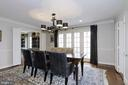 Formal dining room with french doors to patio. - 6951 GREENTREE RD, BETHESDA