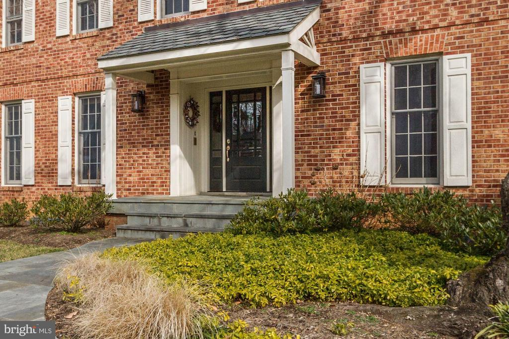 Gracious stone lead-walk and front porch. - 6951 GREENTREE RD, BETHESDA