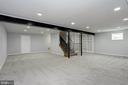 Multipurpose recreation room in the basement. - 6951 GREENTREE RD, BETHESDA