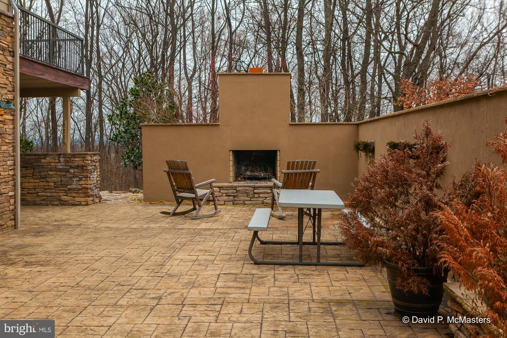 Enclosed patio with outdoor fireplace - 212 CICADA DR, MARTINSBURG