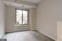Carpeted Bedroom featuring Large Window - 7500 WOODMONT AVE #S208, BETHESDA