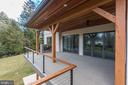 Main level deck with stone fireplace, pano doors - 9604 PEMBROKE PL, VIENNA