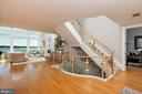 Entry,  white oak flooring  and glass stair well - 740 S RIVER LANDING RD, EDGEWATER