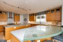 Curved glass countertop, Canadian artist. - 740 S RIVER LANDING RD, EDGEWATER