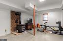 Wood stove in the basement. - 115 GOLD RUSH DR, LOCUST GROVE