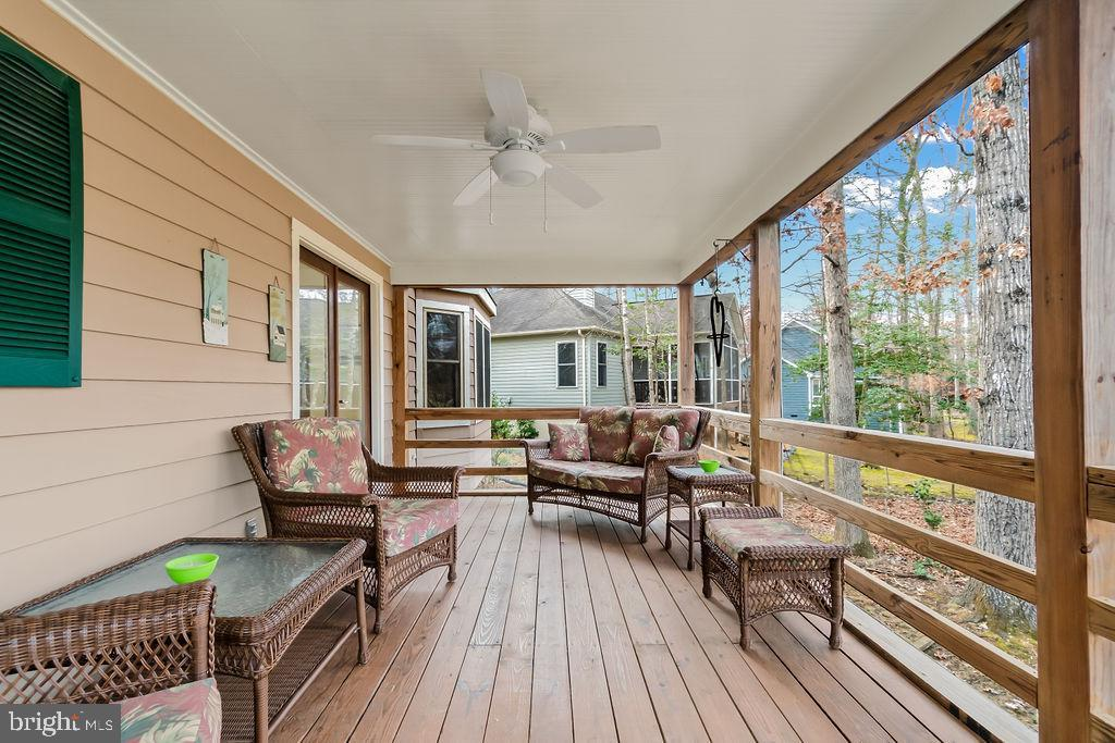 Screened in porch with ceiling fan - 115 GOLD RUSH DR, LOCUST GROVE