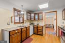 Kitchen with granite countertops - 115 GOLD RUSH DR, LOCUST GROVE