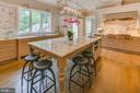 With a commercial style gas cooktop and hood... - 11134 STEPHALEE LN, NORTH BETHESDA