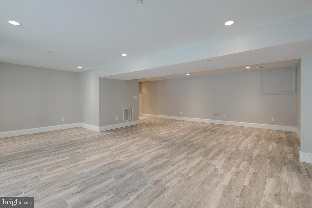 Downstairs, you'll find a huge rec room... - 11134 STEPHALEE LN, NORTH BETHESDA