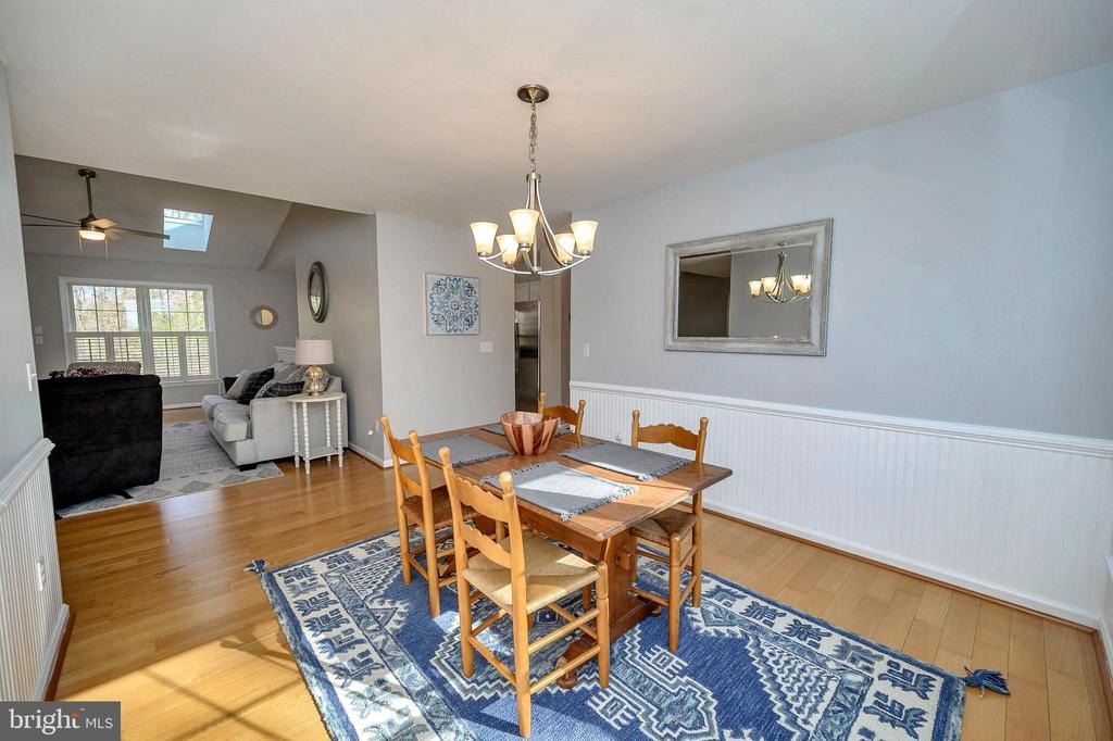 Dining room opens to living room - 104 CEDAR CT, LOCUST GROVE