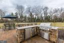 Outdoor kitchen with grill, fridge, and trashcan - 38261 VALLEY RIDGE PL, HAMILTON