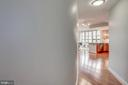 Enter through a curved hallway - 888 N QUINCY ST #1701, ARLINGTON