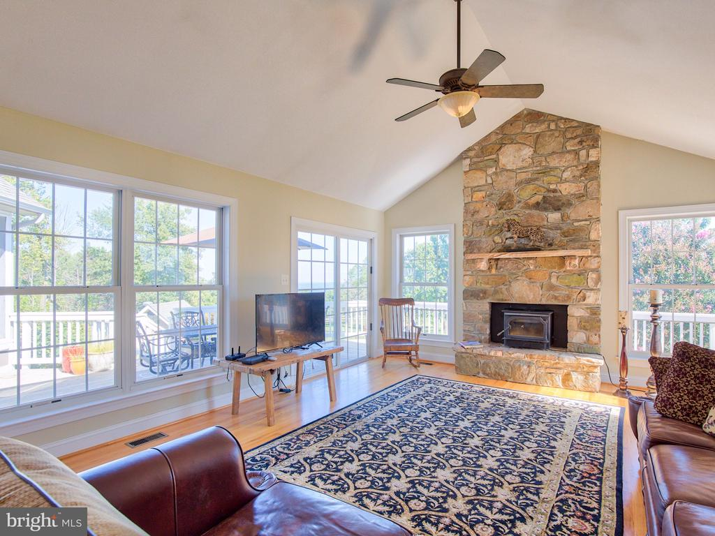 Stone fireplace with wood insert. - 17244 RAVEN ROCKS RD, BLUEMONT