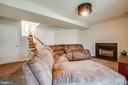 Basement rec room with wood burning fireplace - 121 LONGVIEW DR, STAFFORD
