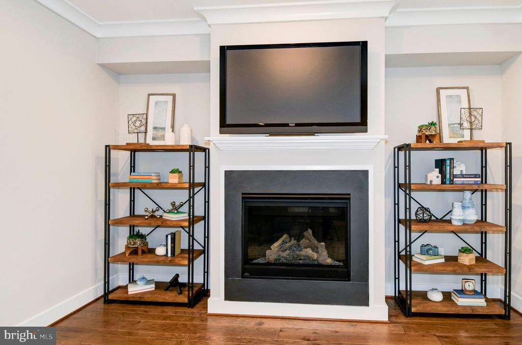 Cozy up by the fire and watch your favorite show. - 6103 OLIVET DR, ALEXANDRIA