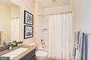 The second floor bath offers a shower tub combo. - 6103 OLIVET DR, ALEXANDRIA