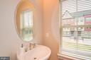 A powder room on the second floor. - 6103 OLIVET DR, ALEXANDRIA