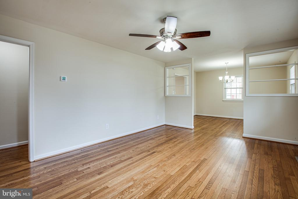 These refinished hardwood floors shine - 806 PAYTON DR, FREDERICKSBURG