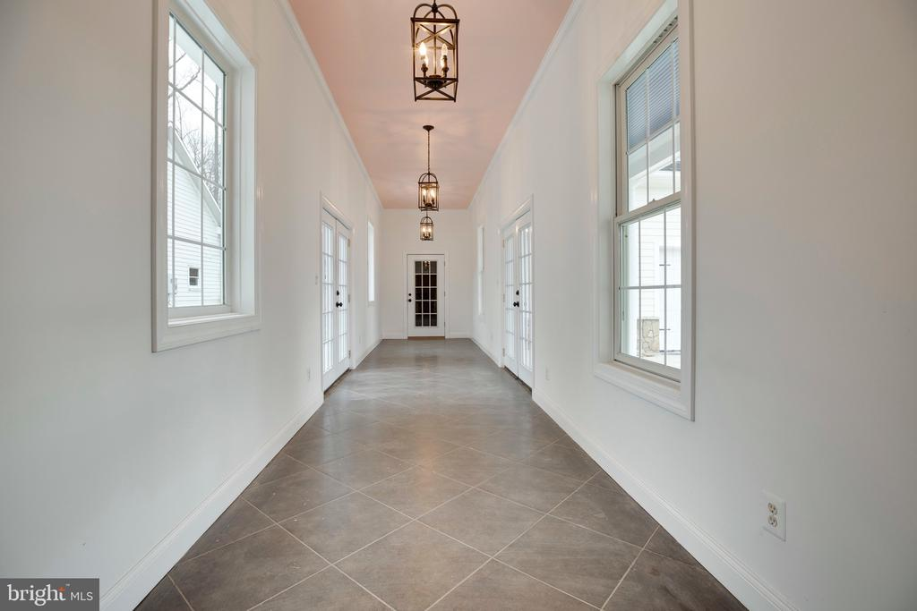 Connecting hall from garage to mud-room - 7355 CLIFTON RD, CLIFTON