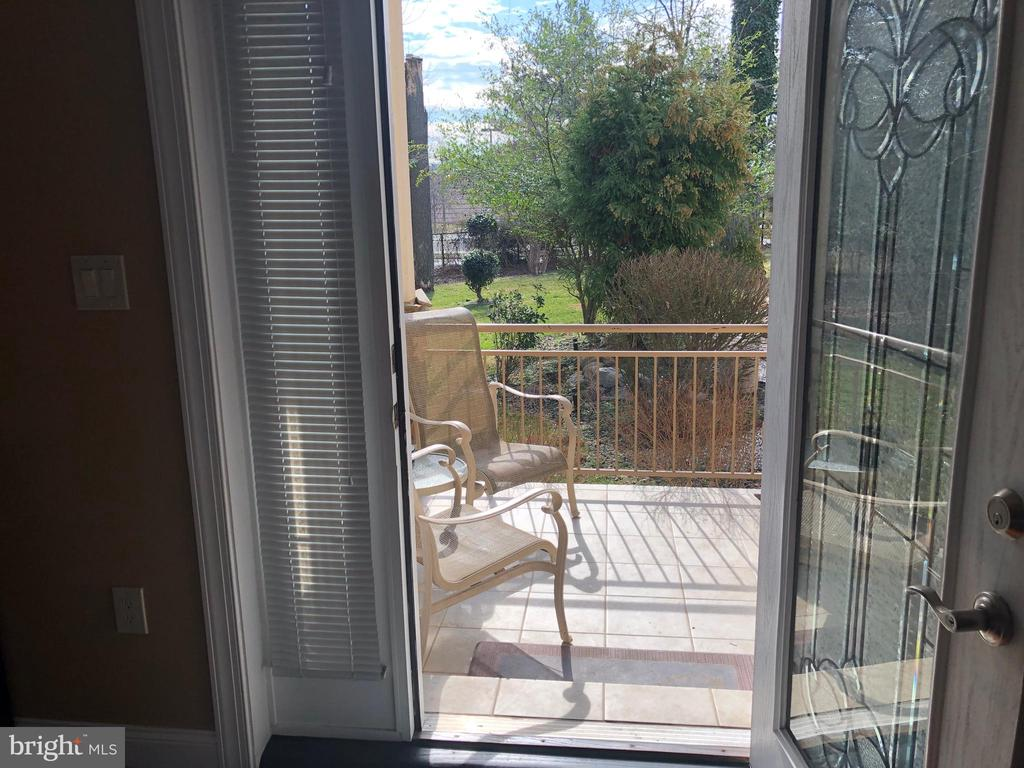 Covered patio off of the Master rear door. - 6809 CALVERTON DR, HYATTSVILLE