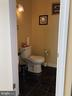 Half bath in center hall. - 6809 CALVERTON DR, HYATTSVILLE