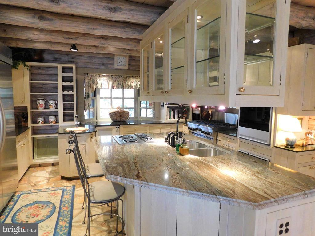 Kitchen with display cabinets above. - 11713 WAYNE LN, BUMPASS