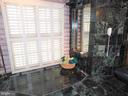 Master Bathroom: sunken jacuzzi tub with Plexiglas - 11713 WAYNE LN, BUMPASS