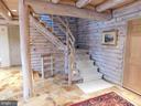 Foyer - rustic logs and stone flooring - 11713 WAYNE LN, BUMPASS