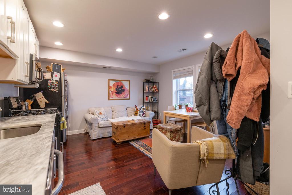 Unit 1: Living Room/Kitchen - 725 HOBART PL NW, WASHINGTON