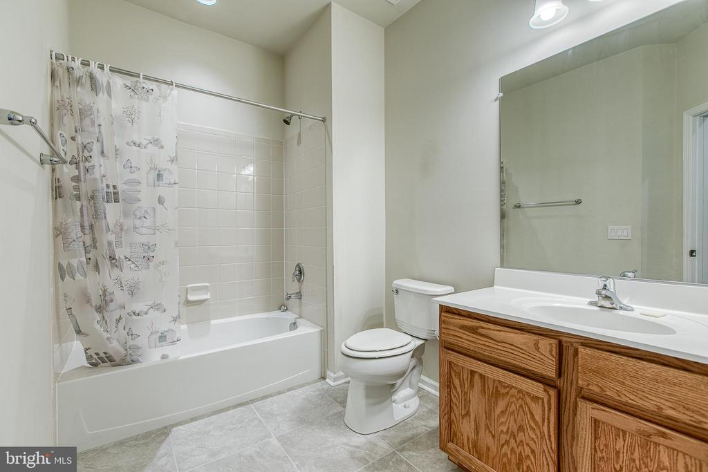 Full bath with large vanity and new tiled floors - 220 LONG POINT DR, FREDERICKSBURG