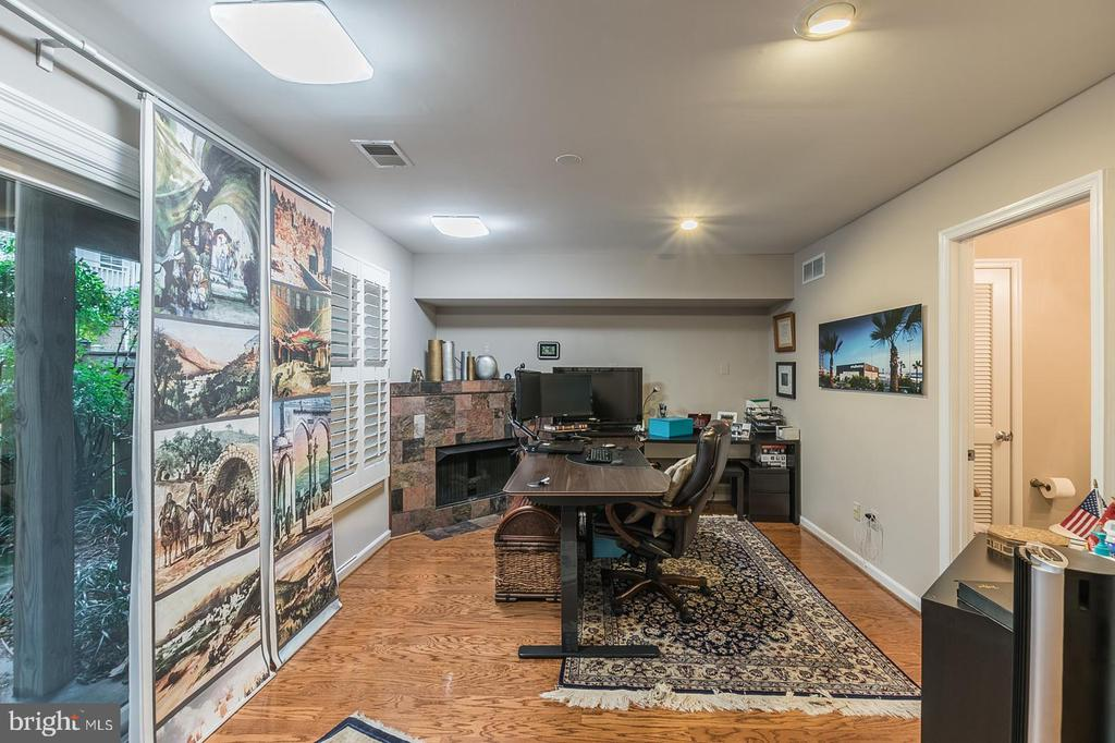 lower level recreation room with fireplace - 11485 WATERHAVEN CT, RESTON