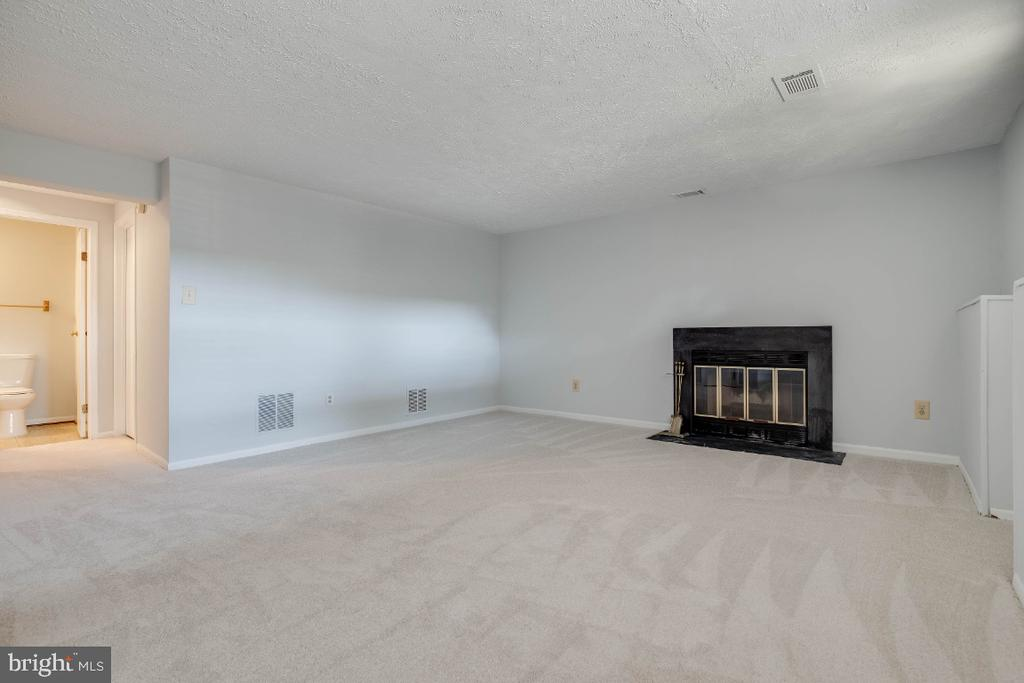 Large rec room in the basement with fireplace - 1809 TILLETSON PL, WOODBRIDGE