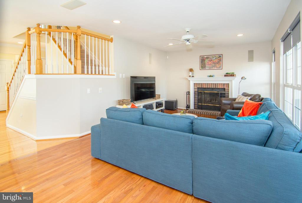 Family room with wood burning fireplace! - 6477 EMPTY SONG RD, COLUMBIA