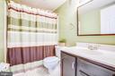 Main level bath is one of three full baths in home - 6122 PLAINVILLE LN, WOODBRIDGE