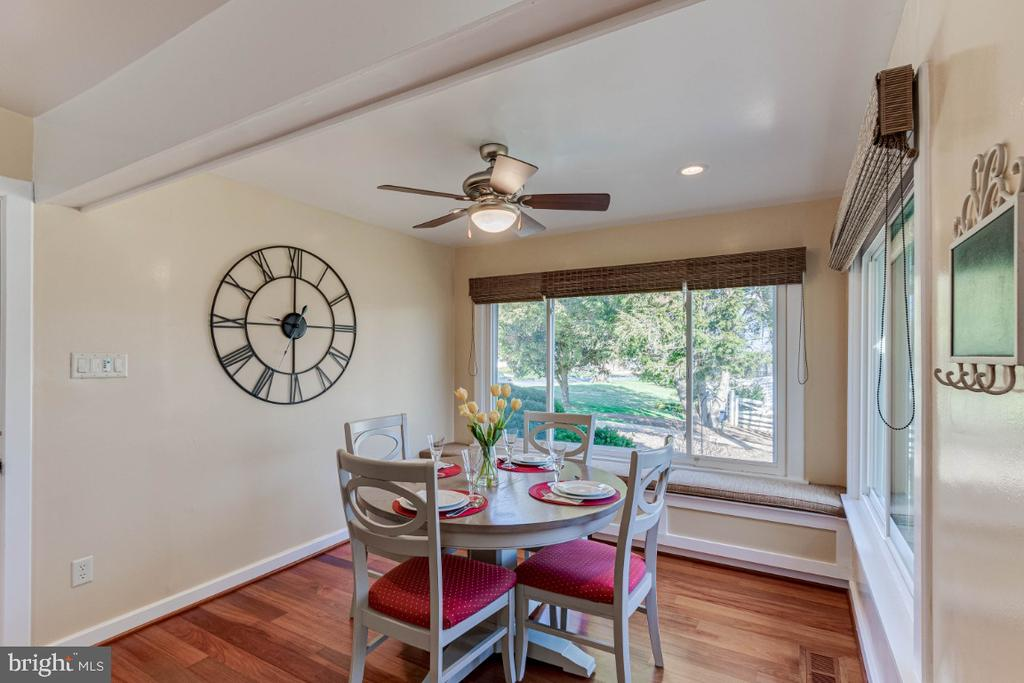 Large Windows Surround the Kitchen Eating Area - 10907 WATERMILL CT, OAKTON