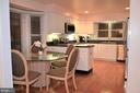 Kitchen has large eat-in dining area - 5827 WESSEX LN, ALEXANDRIA