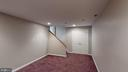 One more level down for a movie room/man cave - 56 DOROTHY LN, STAFFORD