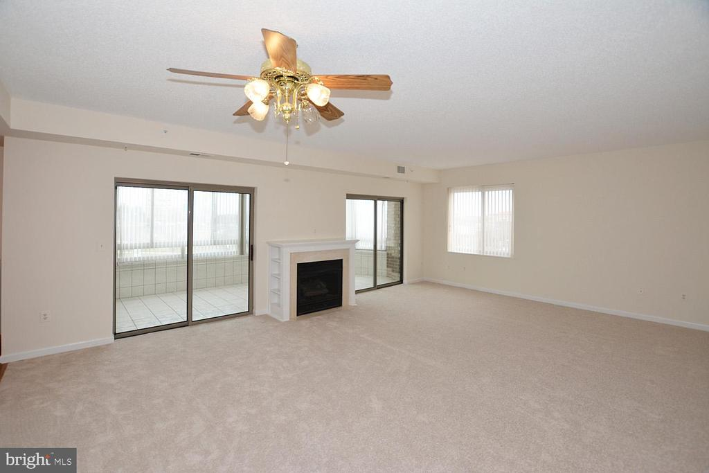 Two sliding glass doors leading to sunporch - 19375 CYPRESS RIDGE TER #107, LEESBURG
